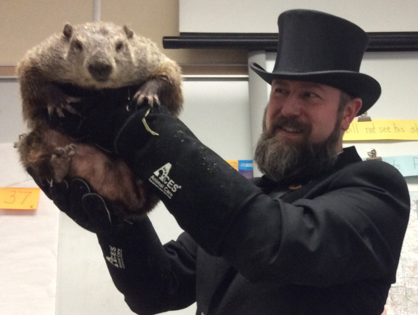 Punxsutawney Phil checks out the students at Reid Elementary School while being held aloft by co-handler A.J. Dereume of the Groundhog Club's Inner Circle in this January 2018 photo.