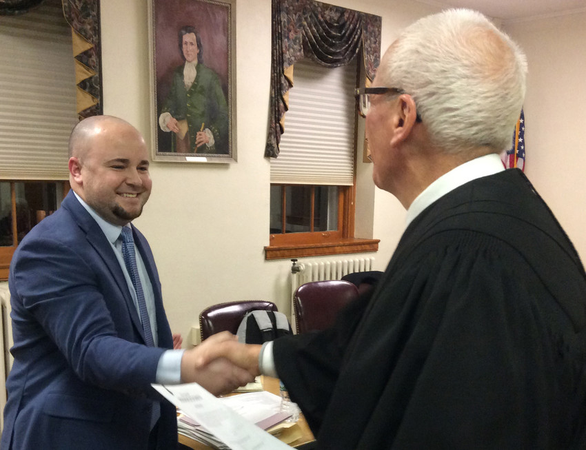 Middletown Borough Councilor Ben Kapenstein accepts congratulations from District Judge David Judy after being sworn into a new two-year term in January.