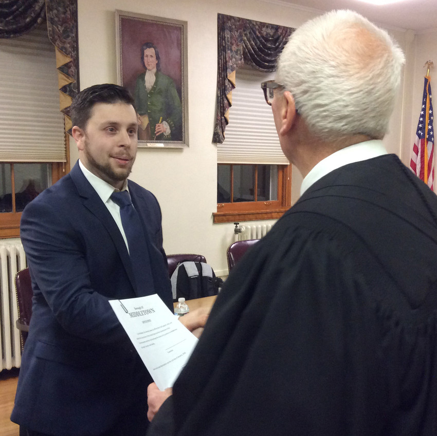 Middletown Borough Councilor Ian Reddinger accepts congratulations after being given the oath of office for a four-year term on council by District Judge David Judy in this 2018 file photo.