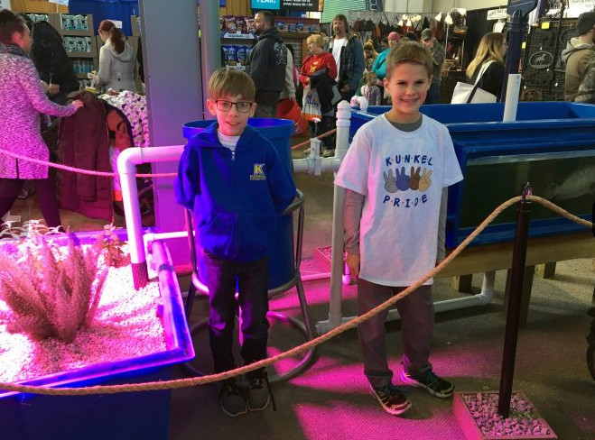 Kunkel Elementary School fourth-graders Max Williams and Will Korsak stand among the INTAG displays Sunday, Jan. 7, at the 102nd Pennsylvania Farm Show.