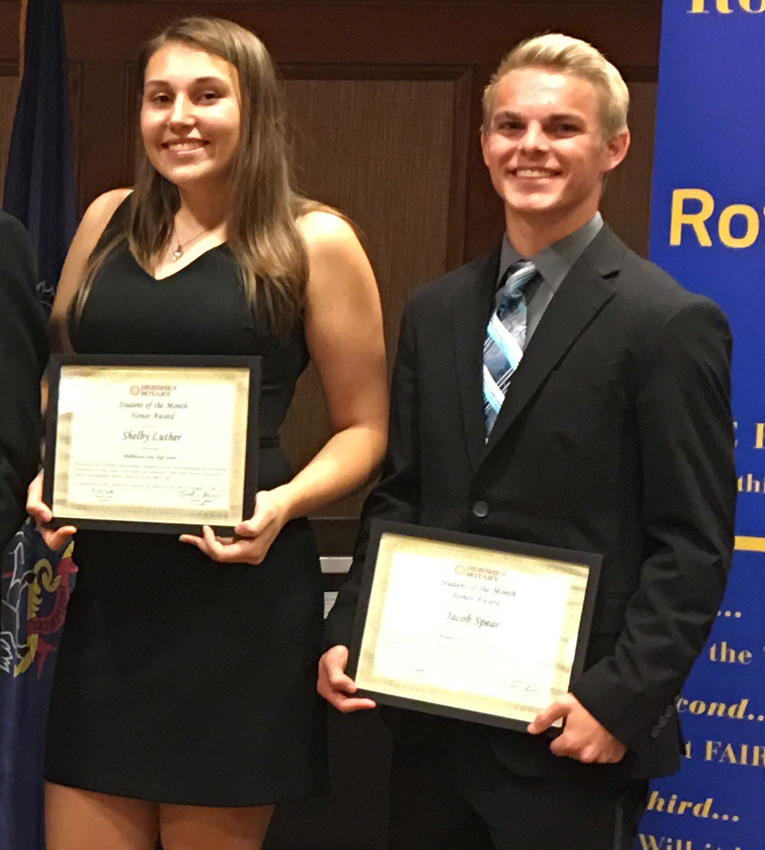 Middletown Area High School seniors Shelby Luther and Jacob Spear hold their certificates from the Hershey Rotary Club.