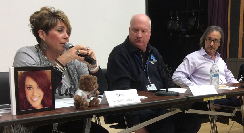 Wendy Loranzo speaks during the Feb. 15 panel discussion at Penn State Harrisburg about opioid addiction. Jim Lingg and Eric Doerfler listen.