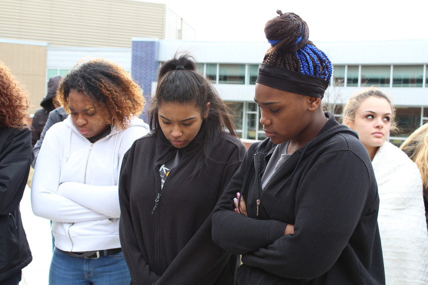 Juniors Jam'esha Thomas-McDonald and Kashea Brown took part in the moment of silence March 14 at Middletown Area High School.