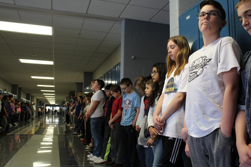 Middletown Area Middle School students stood shoulder-to-shoulder in silence March 14 as 17 chimes played over the intercom in memory of the people who died in Parkland, Florida.