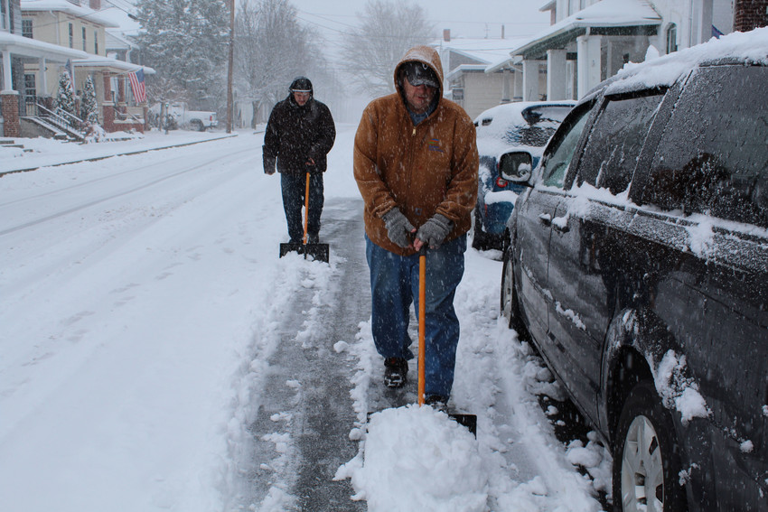 Randy Kennedy and Tyler Bangert cleared snow from the street in this March 2018 photo.