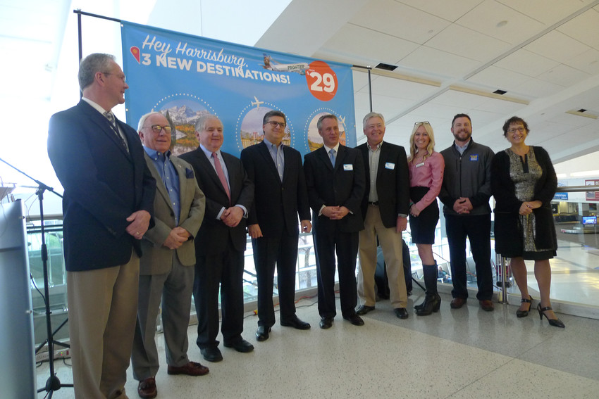 Harrisburg International Airport Executive Director Tim Edwards (far left) joins other HIA officials and representative of Frontier Airlines during the announcement of new nonstop service between HIA and Denver, Raleigh/Durham, and Orlando.