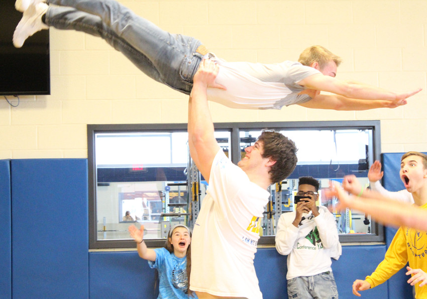 "Brendan Douglass lifts Jacob Spear in the air while they practice their ""Dirty Dancing""-inspired dance on Thursday, March 29 at Middletown Area High School."