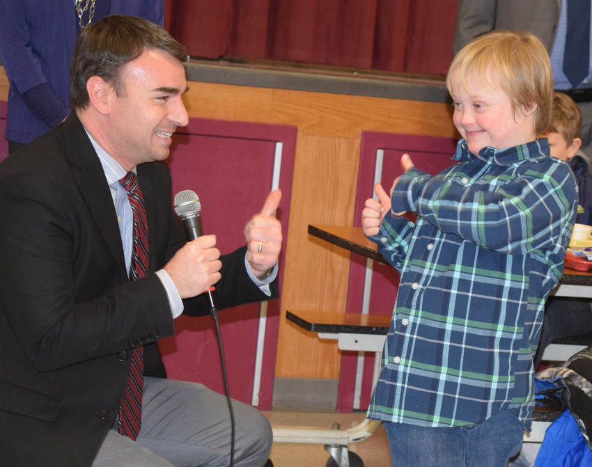 South Hanover Elementary School Principal Steve Schoessler exchanges thumbs-up with Phineas Howarth.