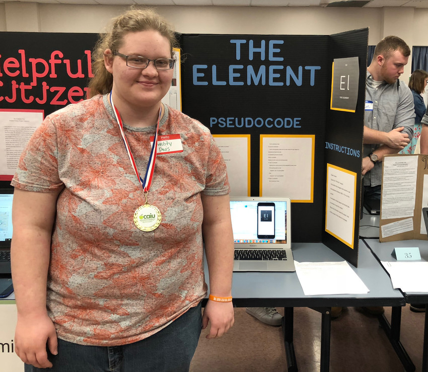 Middletown Area High School senior Chastity Davis shows off her winning project in the Programming Division of the Capital Area Intermediate Unit regional Computer Fair.