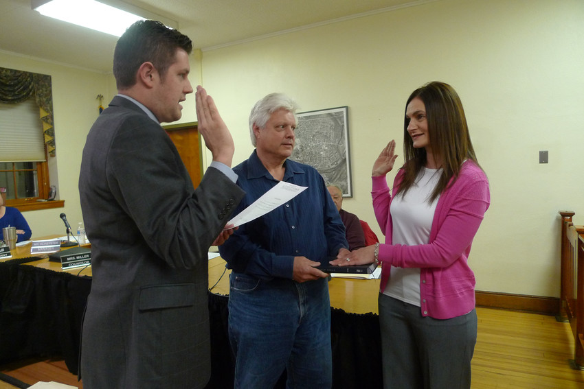Mayor James H. Curry III swears in Angela Lloyd to the borough council on Tuesday, April 3. Council President Damon Suglia is in the middle.