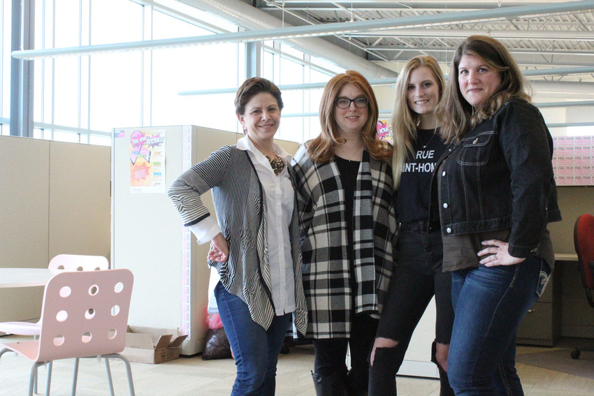 Feel Your Boobies Founder Leigh Hurst, left, stands last month with the other staff members, from second left, Meaghan Abbott, Liv Friedrich and Alli Matson in the organization's new home in Swatara Township.