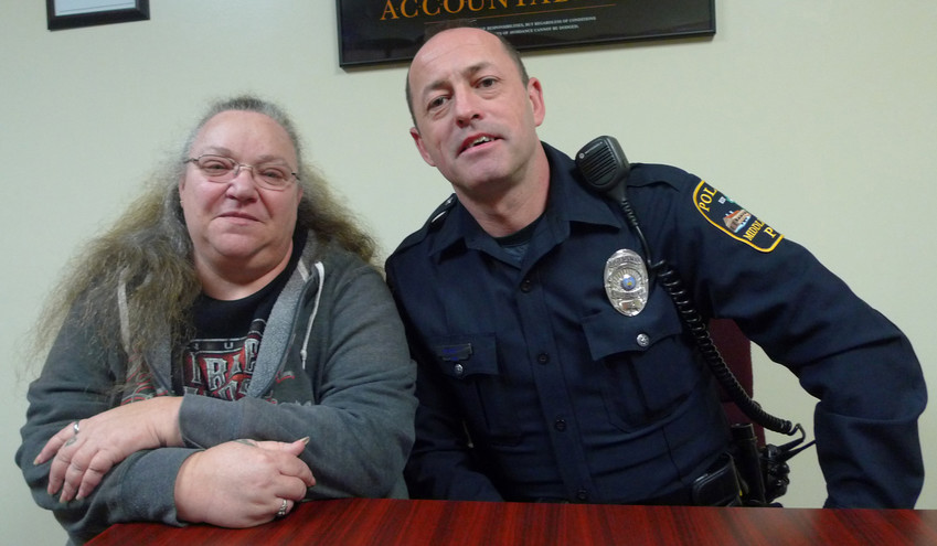 Terri Coble and Patrol Officer James Bennett got together Monday at the Middletown police station. They played instrumental roles in helping rescue a Londonderry Township man who had fallen in his backyard. The key action, however, was taken by a Shih Tzu named Chibbs.