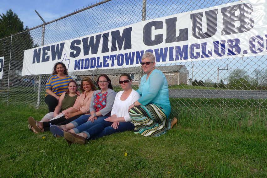 Members of the Middletown Swim Club's new board of directors pose in front of a banner promoting changes at the club coming in the 2018 season. From left are board President Jan Webb and members Jessica Nordai, Amanda Moore, Kelly Templeton, Stefanie Crater, and Melissa Wells.