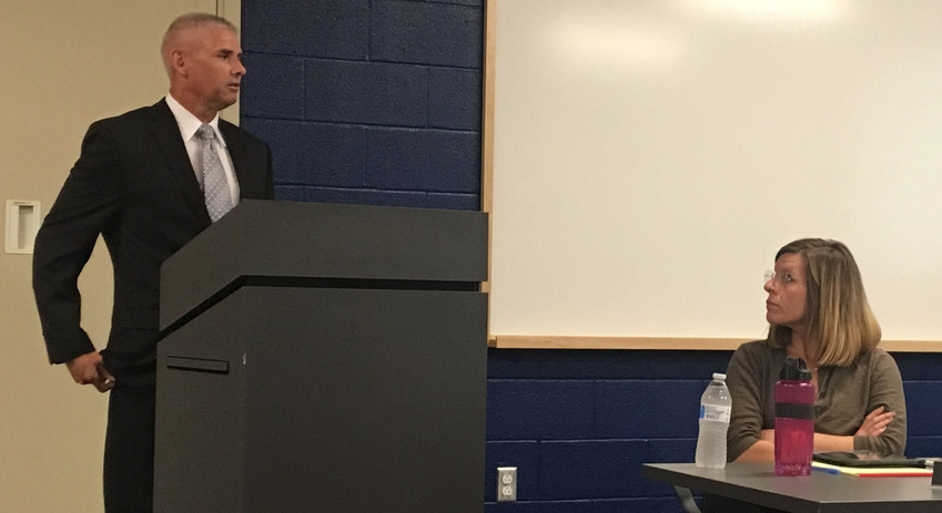 VSG's Brian Krause provided a preview of the results of a risk and vulnerability assessment of MASD buildings to the School Board on June 19. Board member Julie Gomboc-Turyan listens.