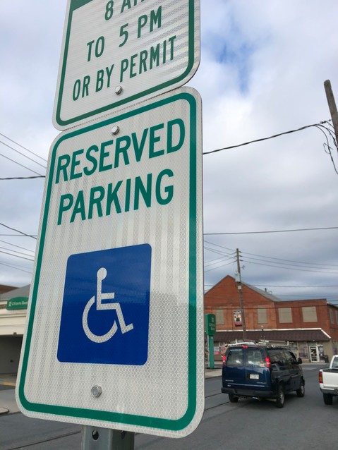 Cars pass by a reserved parking space on Aug. 14 on Brown Street.