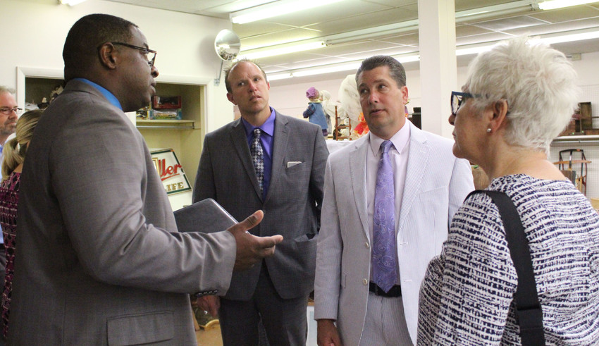 From right, Interfaith Housing Board President Ellen Willenbecher, state Rep. Tom Mehaffie, and Middletown Business Association's Scott Sites listen to George Connor, executive director of Dauphin County Community and Economic Development, during a tour of Vintage Vault Gallery on South Union Street on Monday. The building is owned by the Interfaith Housing Board, which is considering applying for a state gaming grant. Connor and Mehaffie provided feedback during the tour.