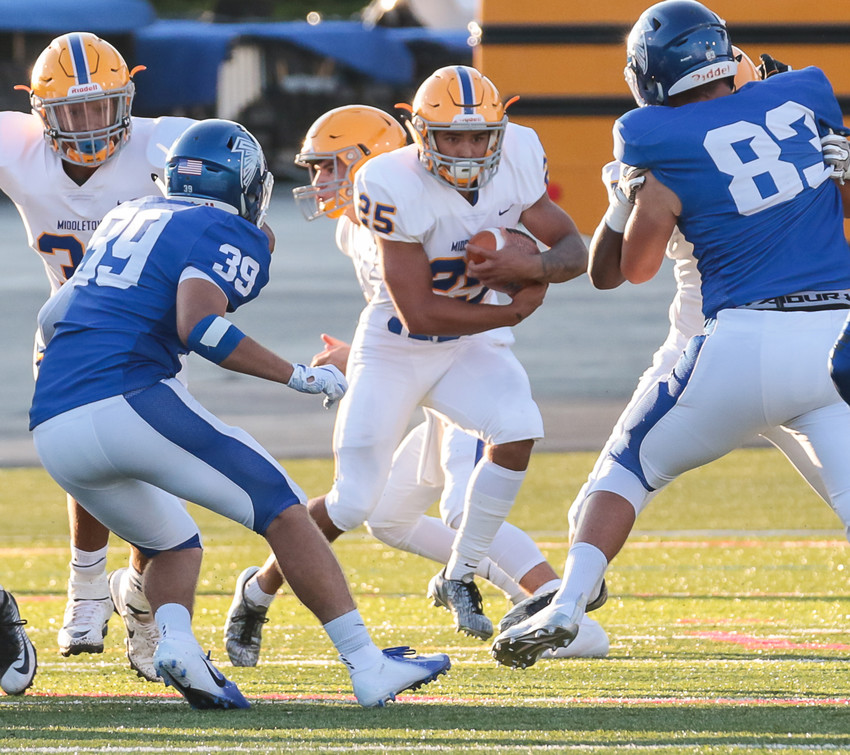 Middletown running back Jose Lopez busts through the line Friday night vs. Lower Dauphin at Hersheypark Stadium. The Blue Raider junior rushed for 167 yards in the 42-14 win.