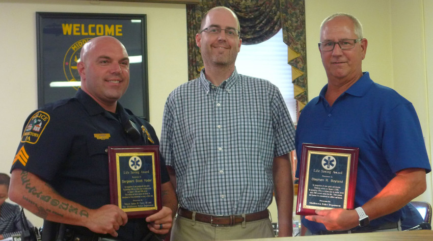 Jim Neuschwander of Derry Township, center, poses with Steve Boyland, right, and Middletown Police Sgt. Scott Yoder after receiving awards at a Middletown Borough Council meeting on Sept. 4.