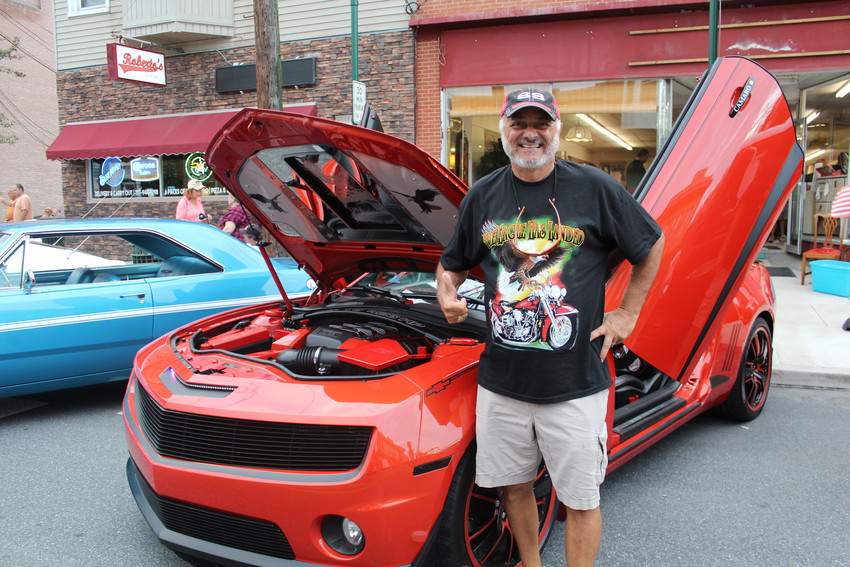 Roy Seixas poses next to his car during Kuppy's Diner Cruise-in on Sept. 13, 2018.