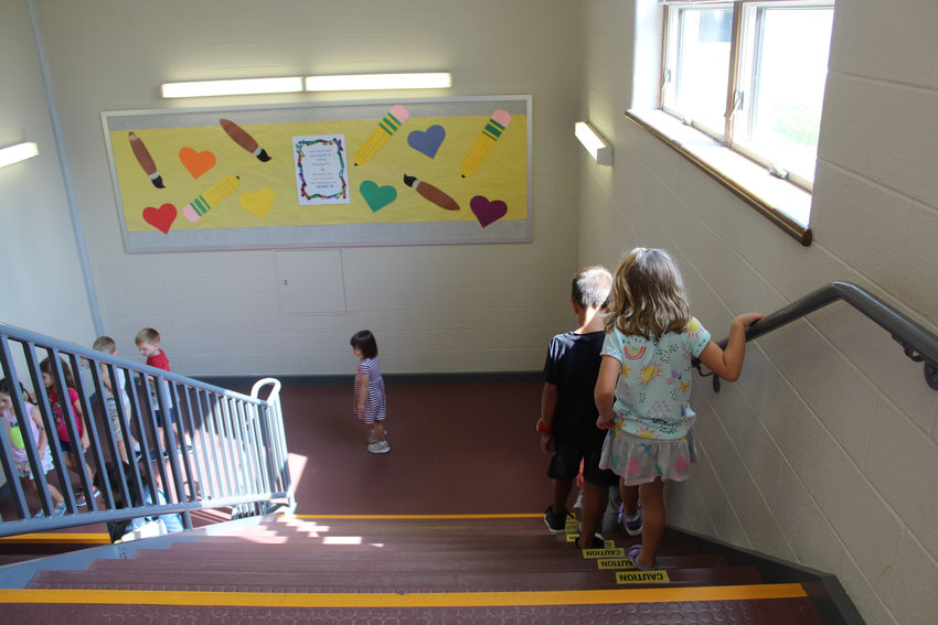 Students walk down the stairs at John C. Kunkel Elementary School in this September file photo.