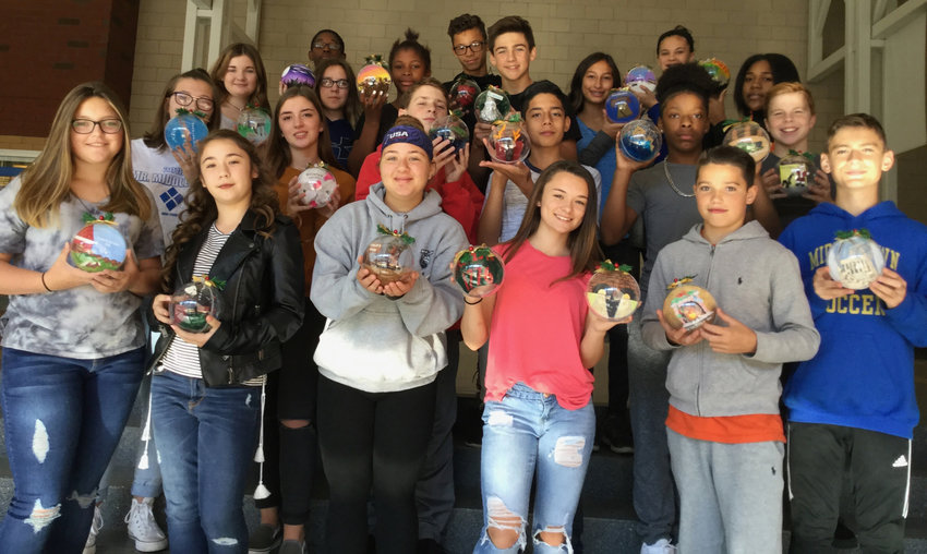 Students in Stacey Miller's eighth-grade art class at Middletown Area Middle School hold the ornaments they made that are to be hung on the tree representing Pennsylvania as part of the National Christmas Tree exhibit in Washington, D.C.