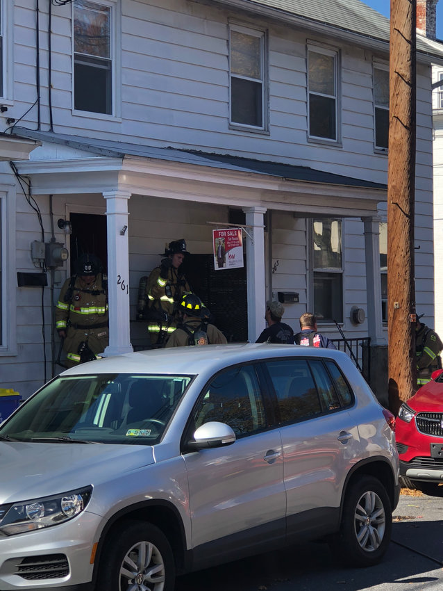 Firefighters leave the home in the 200 block of North Spring Street where smoke was reported Nov. 8.