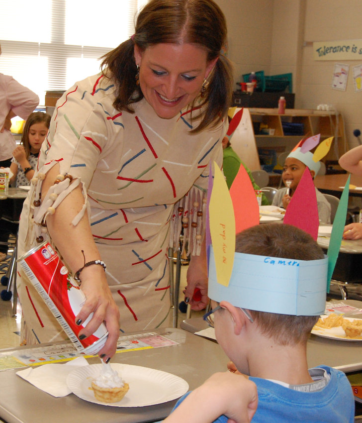 Natalie Cibort decorates a cupcake during Thanksgiving festivities in her second grade classroom at Reid Elementary School in this 2014 photo.