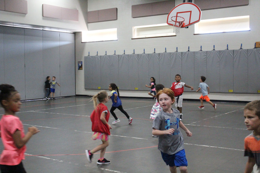 Students play in the Kunkel Elementary School gym in September.