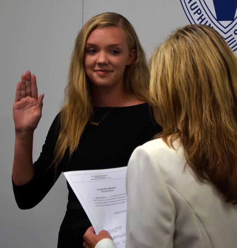 Emma McQuinn takes the oath of office from Lower Dauphin School Board secretary Sharon Hagy.