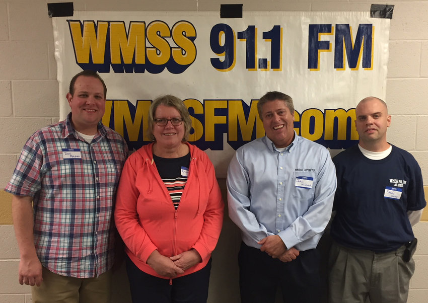 From left are Dan Magaro, WMSS production manager; Maureen Denis, former WMSS faculty adviser and volunteer; WMSS general manager John Wilsbach; and sports director Steve Leedy. They were four of about 30 people to attend a 40th anniversary reunion for the station Oct. 13.