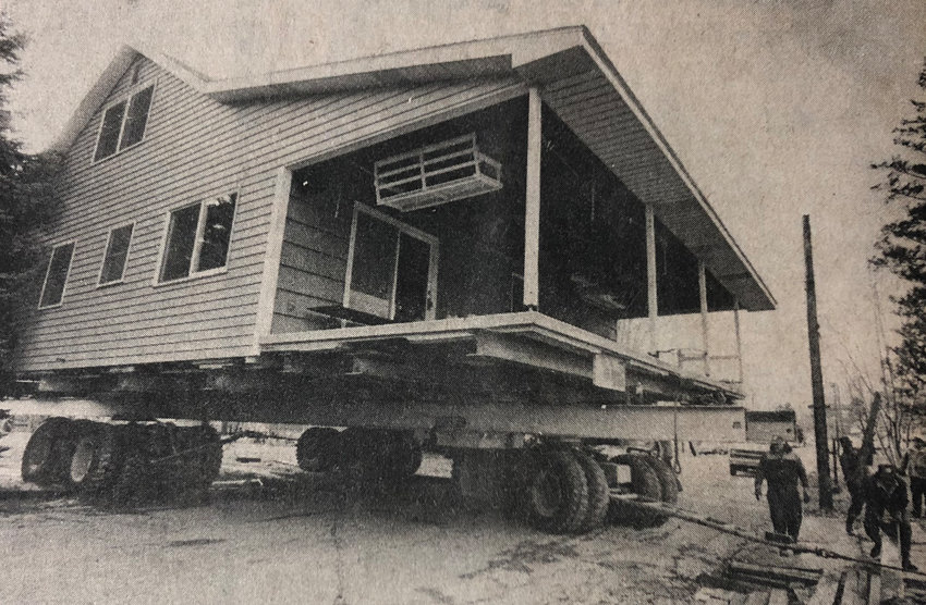 On Thursday, Nov. 29, the former home of Jack and Mary Hamman was moved from its Susquehanna Street plot, bound for a site on nearby Catherine Street. The move was the culmination of years of court battles. The house is pictured crossing Susquehanna Street. Contractor Francis I. Gerrick performed the move. Cliff Bailey, Mrs. Hamman's son, will live in the house after the move is complete.
