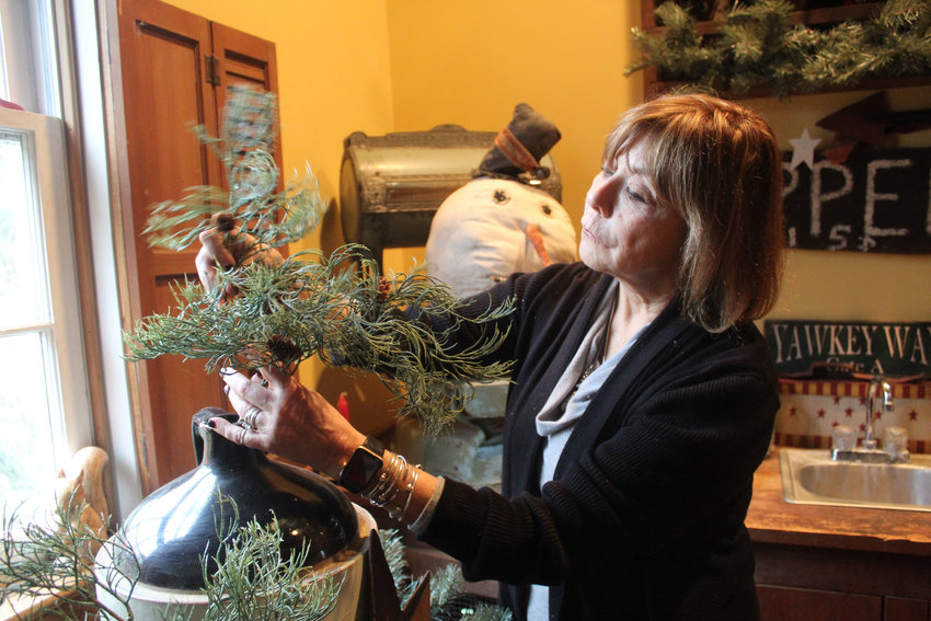 Anne Einhorn decorates her home in preparation for the Middletown Holiday Home Tour on Dec. 8.