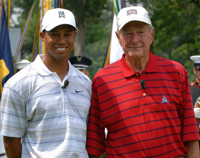 Former President George H.W. Bush, an avid golfer, poses with Tiger Woods.