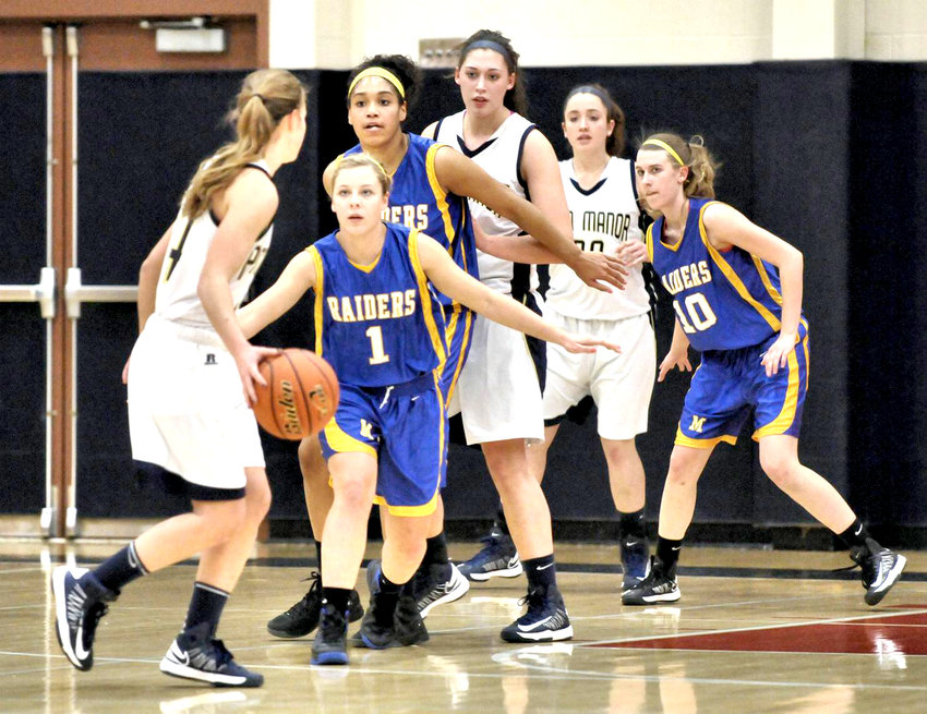 Middletown's Halle Marion (1), Jada Pettis (back) and Sarah Crippen (10) defend against the Penn Manor offense in the Raiders' victory at Hershey.
