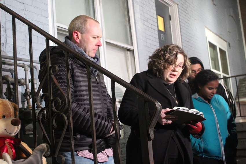 Landlord George Crist organized a vigil for Marvin Caddell, Nightflower Staats and their 7-year-old son on Wednesday night outside of 134 S. Union St.. Pastor Catharine Senft Geib of the Tree of Life Lutheran Church in Harrisburg led the vigil.