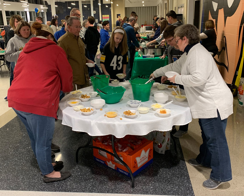 Attendees at Souper Saturday at Middletown Area High School enjoy food Feb. 2.