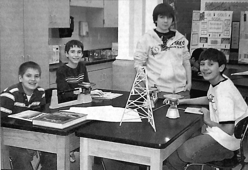 Four middle school students designed a city of the future using recycled materials. The project took third place in a contest hosted by the Whitaker Center on Jan. 12. Their teacher, Jody Weinrich, said the project required a wide range of skills. From left are Tim Krepps, Daniel Reese, Damien McClure and Aaron Gambini.
