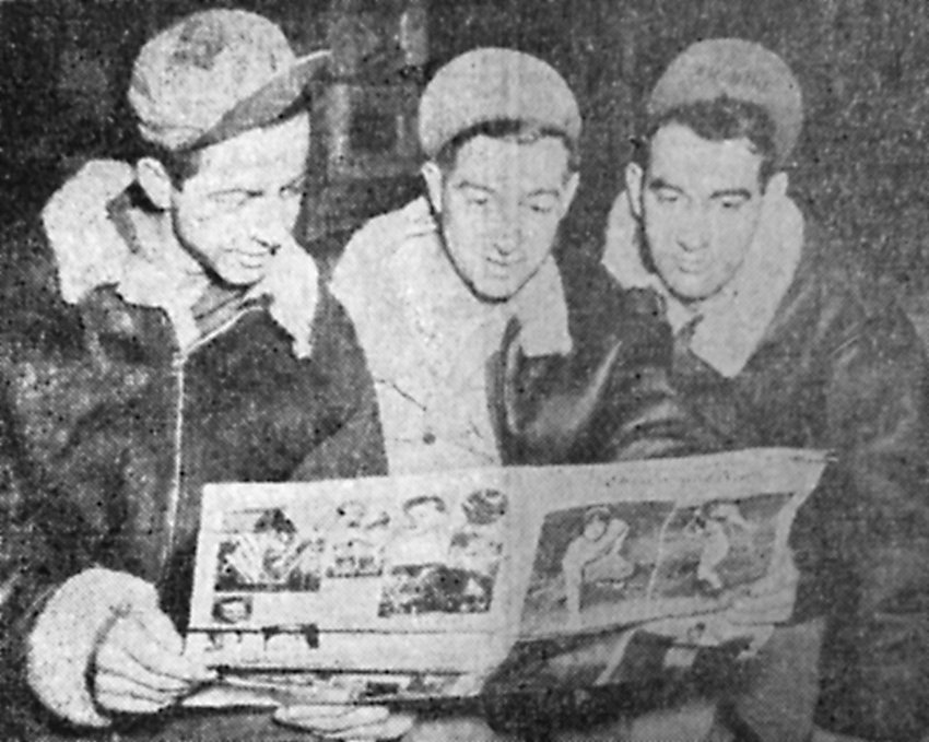 Sgt. William P. Myers, Cpl. Kenneth K. Snavely and Cpl. Newell A. Shireman read news from home while stationed in England.