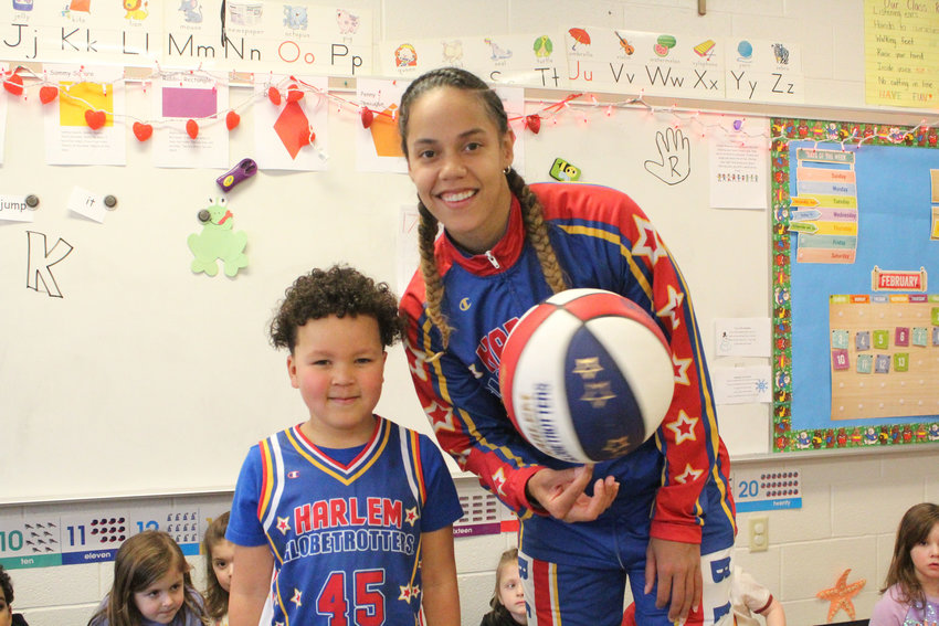 "Harlem Globetrotter's Briana ""Hoops"" Green surprised Kyrie Peay in his pre-school classroom at Seven Sorrows today with a jersey and tickets."