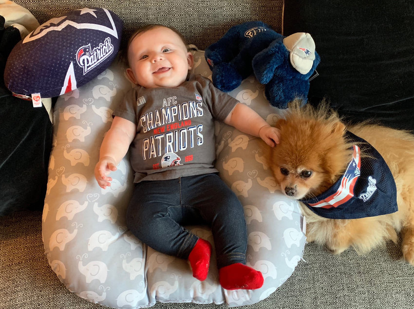 James Miller's daughter Louanne and his dog Rory enjoy the Super Bowl.