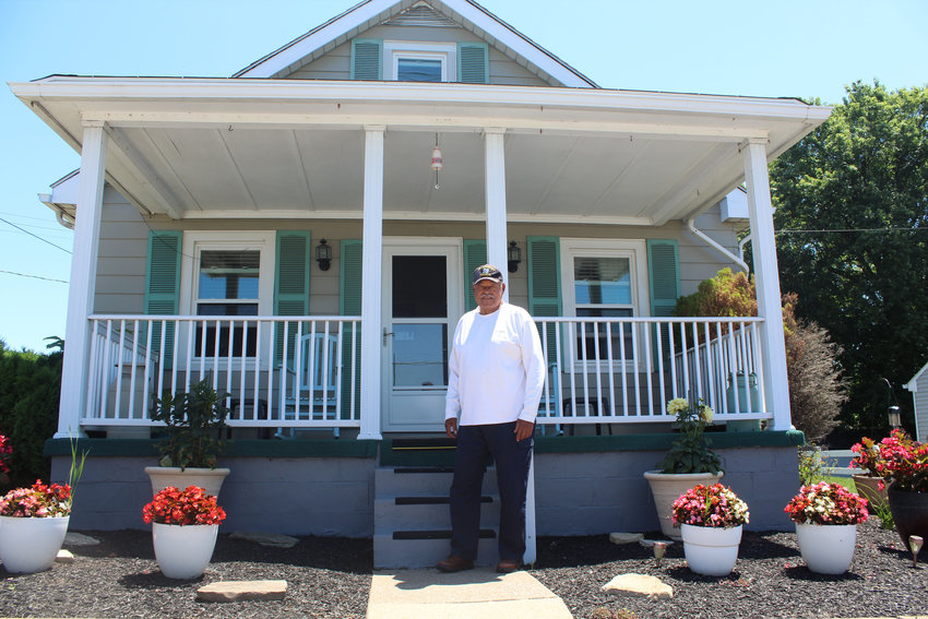 Robert Reid stands in front of his home on Grant Street on July 19. It is within 300 yards of the house in which Reid grew up.