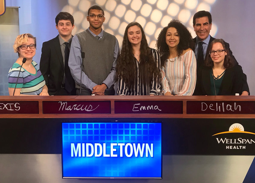 Left to right are Middletown Area High School Quiz Team members Alexis Habbershon, Ryan Souders (alternate), Marcus Williams, Emma Lovell, Delilah Fuentes, BrainBusters host Rich Rosen and Stephanie Finsterbush (alternate).