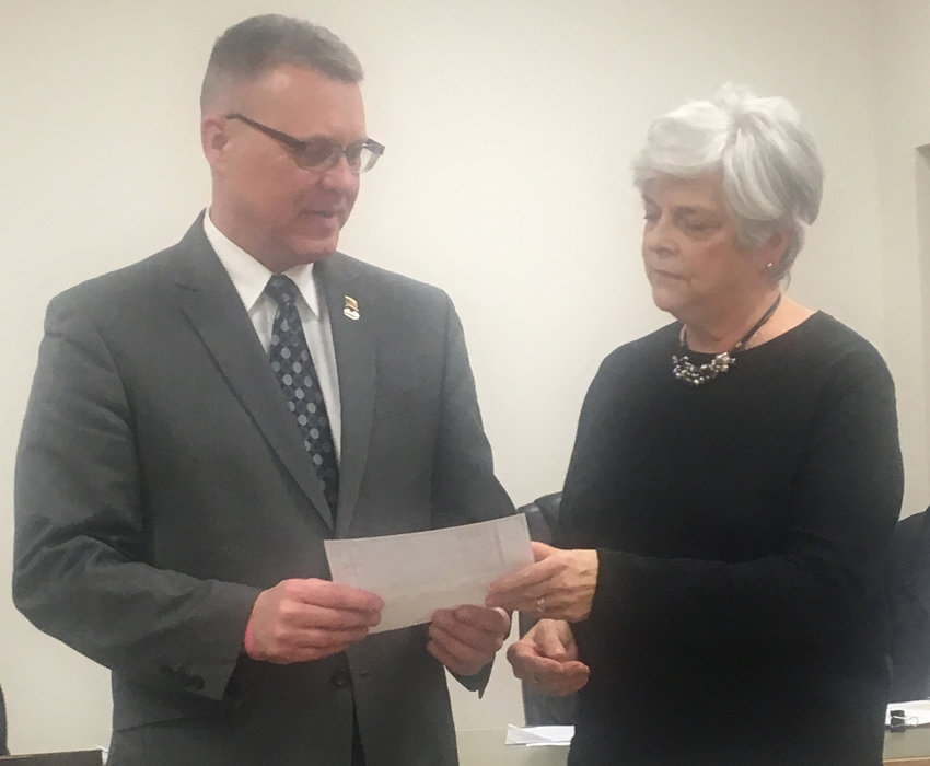 Londonderry Township Board of Supervisors Chairwoman Anna Dale presents a check for $10,331.59 to Doug Etter of the Lebanon VA Medical Center on Feb. 4.