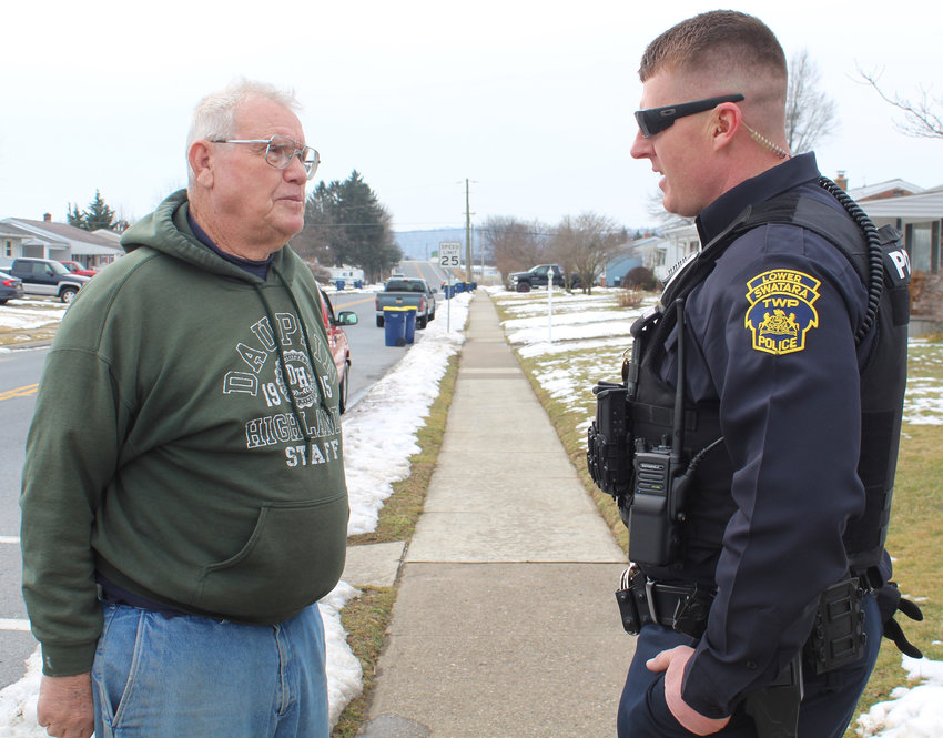 Lower Swatara Officer Jason Heckendorn talks to Joseph Hile while on foot patrol in Shope Gardens on Feb. 22.