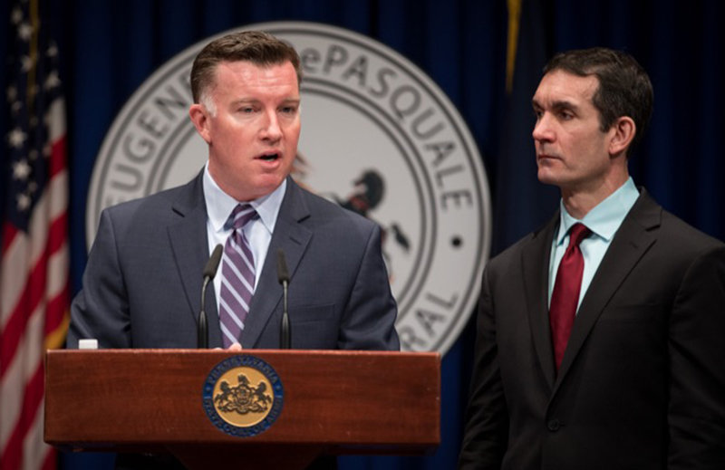 Mark Compton, CEO of the Pennsylvania Turnpike Commission, speaks as Auditor General Eugene DePasquale listens at a press conference on Thursday.