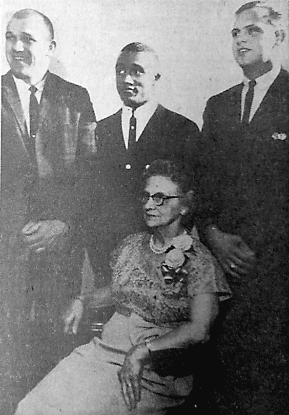 """Honored guests are all smiles for the recognition ceremony staged by local service clubs Monday night. Pictured with Miss Naomi Fickes, former community nurse, from left, Don Gilbert, MAHS football coach, Harvey """"Tony"""" Colston, outstanding Blue Raider athlete, and Joseph Hoover, credited with saving the life of an auto accident victim."""