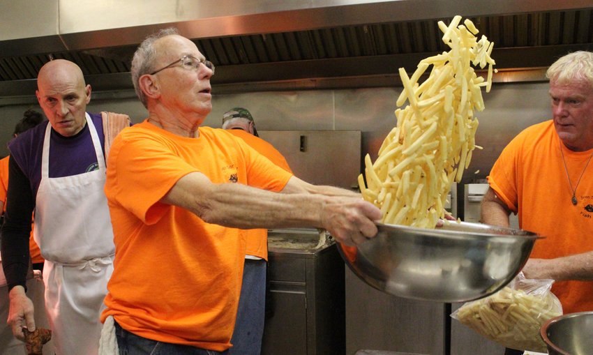 Kenny Scardino flips french fries during the Seven Sorrows fish fry on March 22.