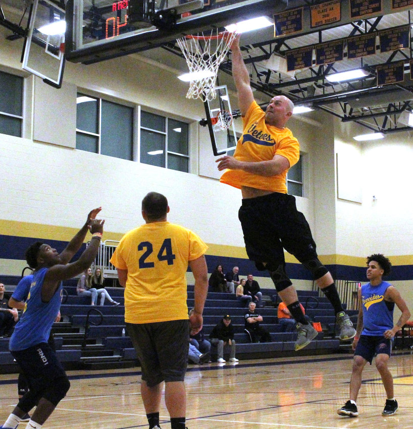 Middletown Police Officer Adam Tankersley goes up for a dunk attempt during Mayoral Madness on March 29 at Middletown Area High School.