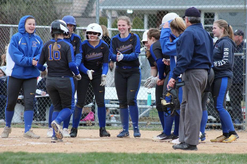 The Middletown softball team congratulates Kate Fitzpatrick, No. 16, on her home run on April 2, part of a 14-4 win at Camp Hill on April 2. The Blue Raiders stand at 2-3 on the season.