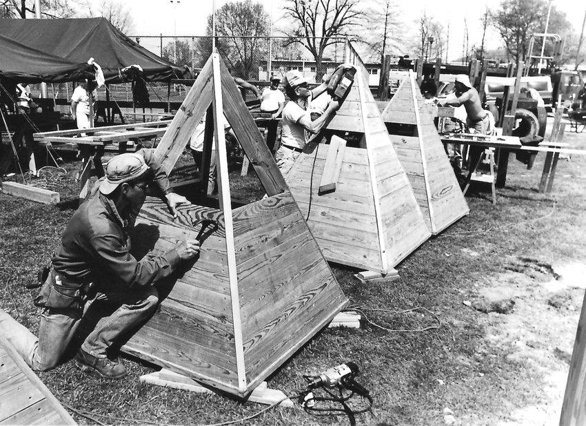 Volunteers work to create the original Kids Kastle in this photo from April 1993.